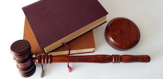 gavel and books on table
